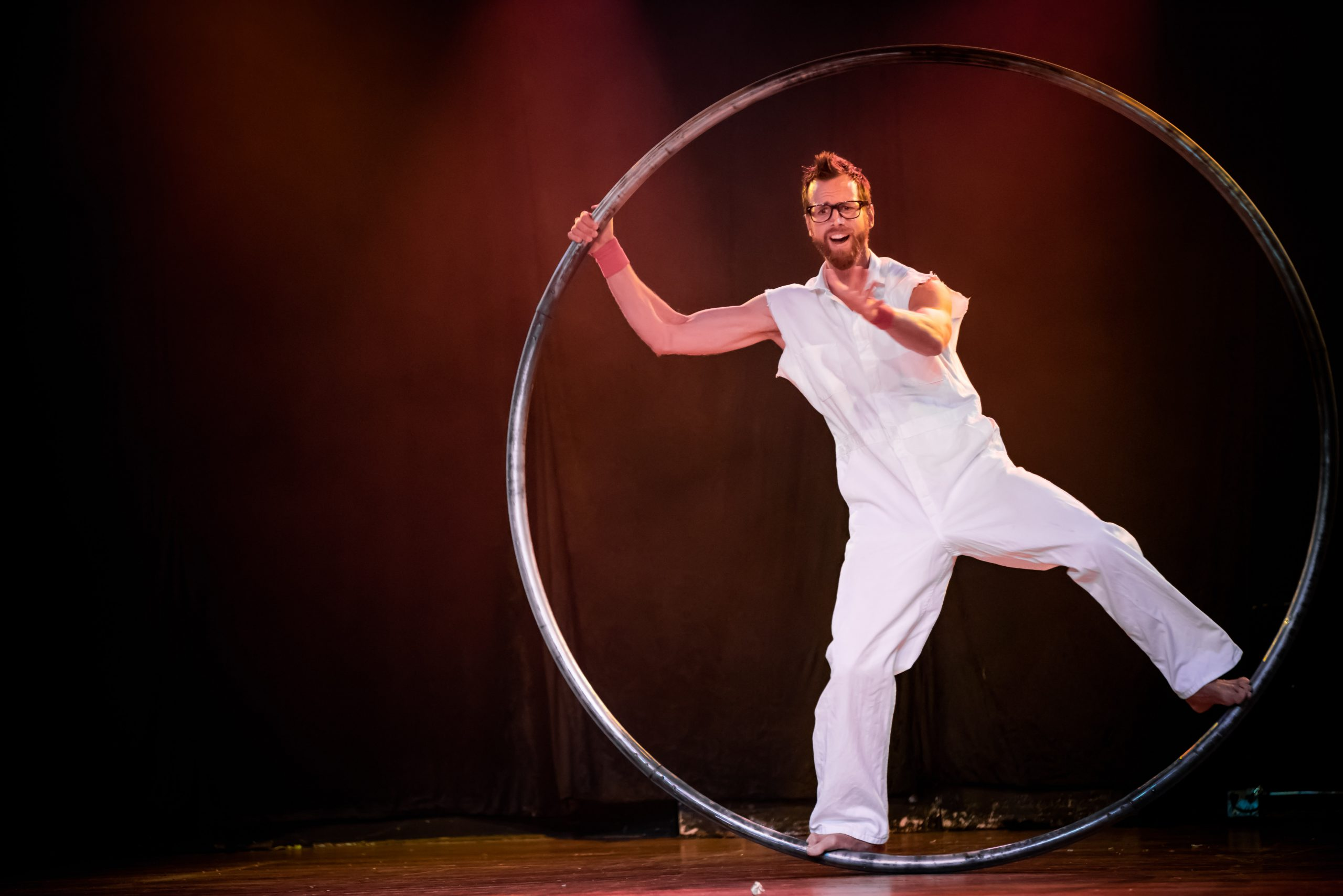 Large hoop performer onstage in Ashland Oregon