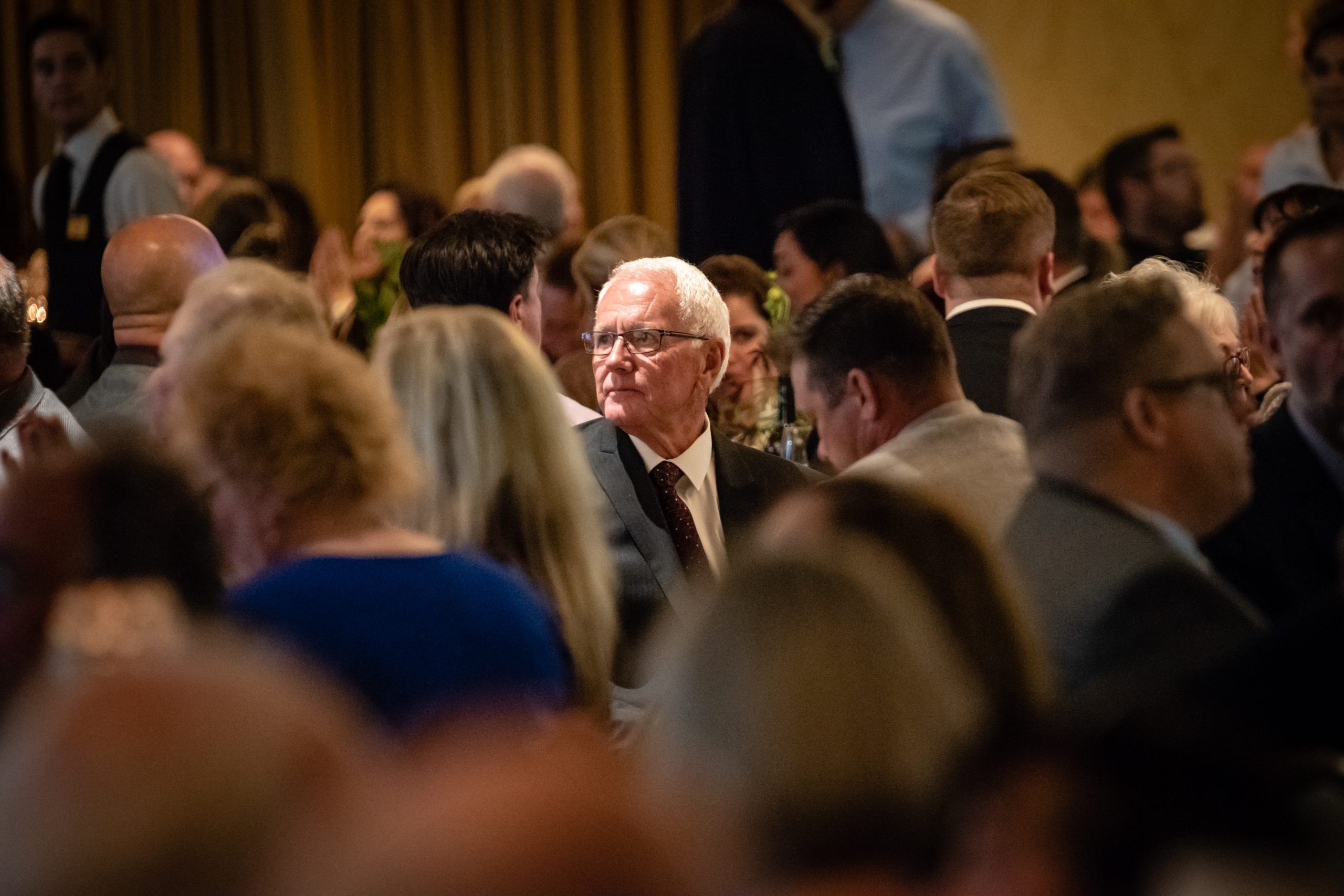 Man in a Crowd at the Medford Chamber Award Ceremony