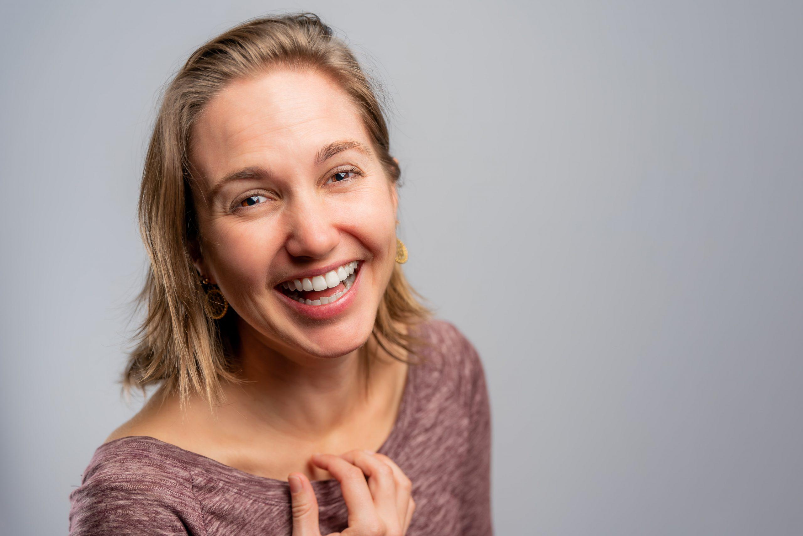 Professional Headshot of Tara on a white background